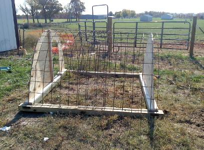 Portable hoop shelter for pasture raised pigs